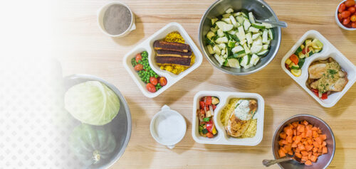 picture of meal trays veggies in bowls