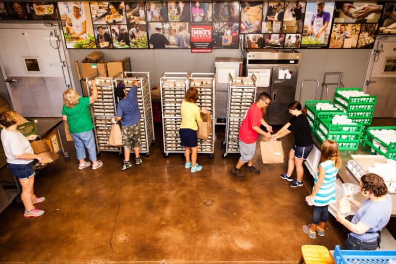 Volunteers pack meal bags