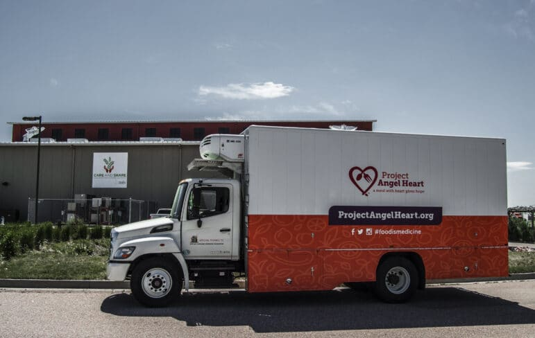 Project Angel Heart's freezer truck parked at Care & Share food bank