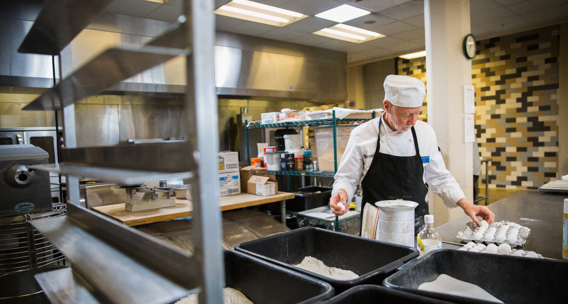 volunteer chef baking in the Project Angel Heart kitchen