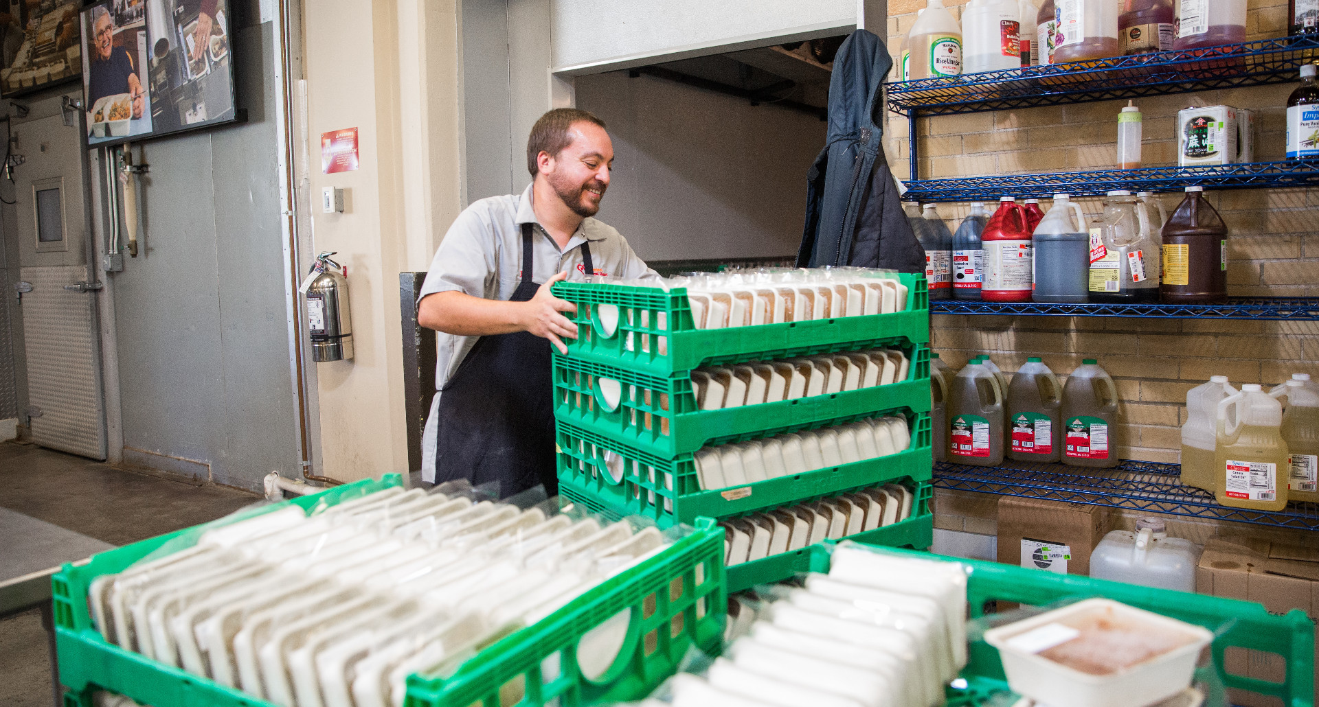 Chef stacking meals in meal trays