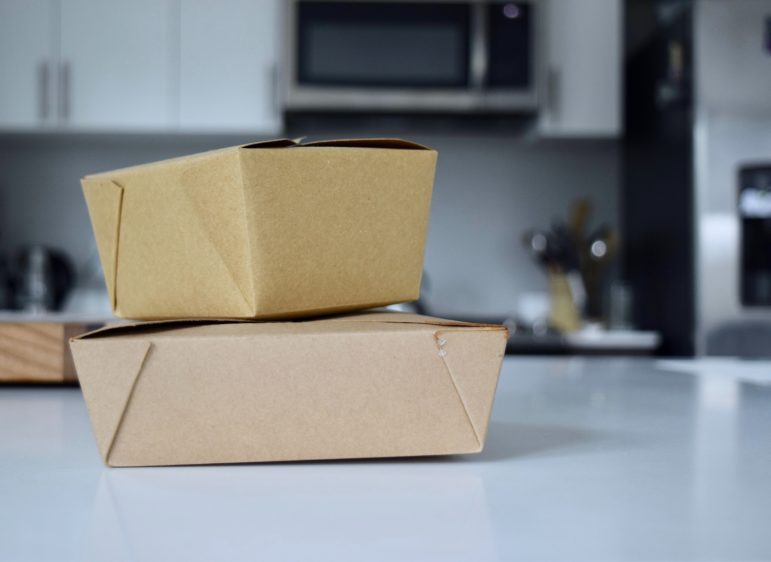 takeout boxes on kitchen counter